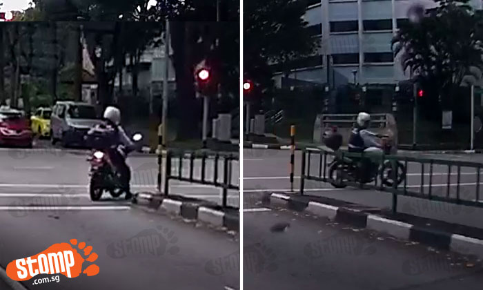 Who's going to 'saman' this LTA officer He beats red light to make illegal U-turn