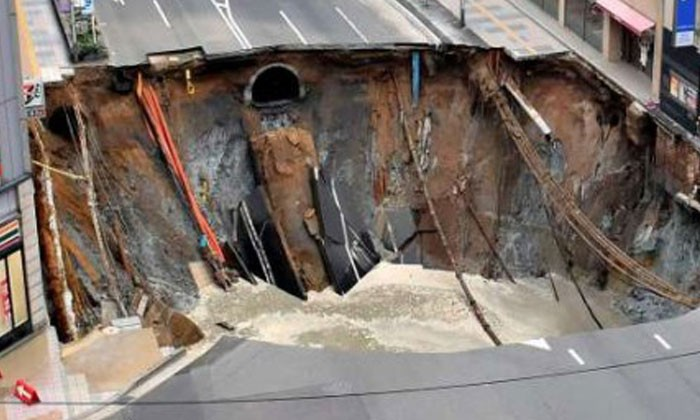 Giant sinkhole swallows up busy intersection in Japan's Fukuoka city