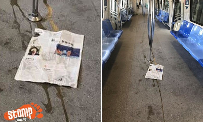 Who did this? Coffee spilled and covered with newspaper in train at Joo Koon