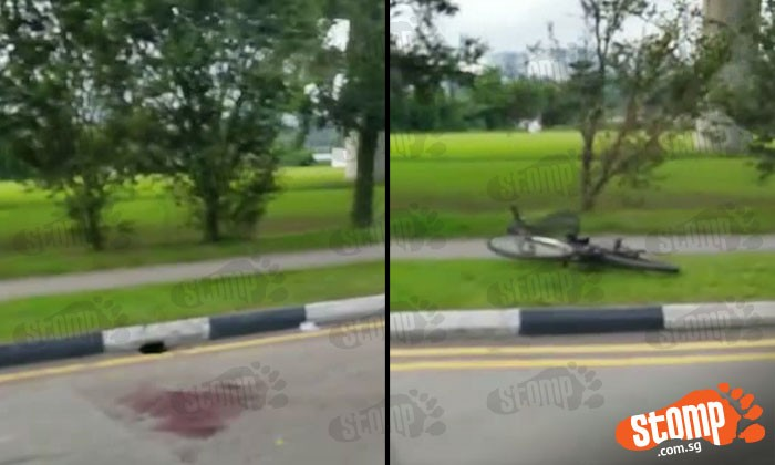 Bike and taxi collide at Boon Lay Way junction: Blood smeared on road