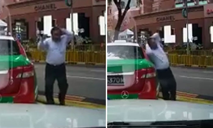 Taxi uncle gets out of taxi -- then suddenly collapses as if he has 'stroke'