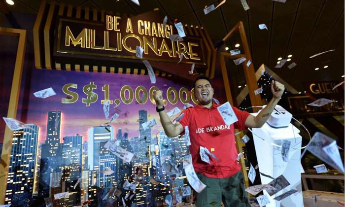 Changi Airport crowns Indonesian Ade Iskandar Roni its seventh Changi Millionaire. Photo by Changi Airport Group