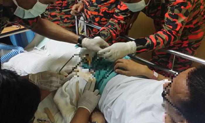Firemen working hard to cut off a penis ring in last year's case. Photo: The Star