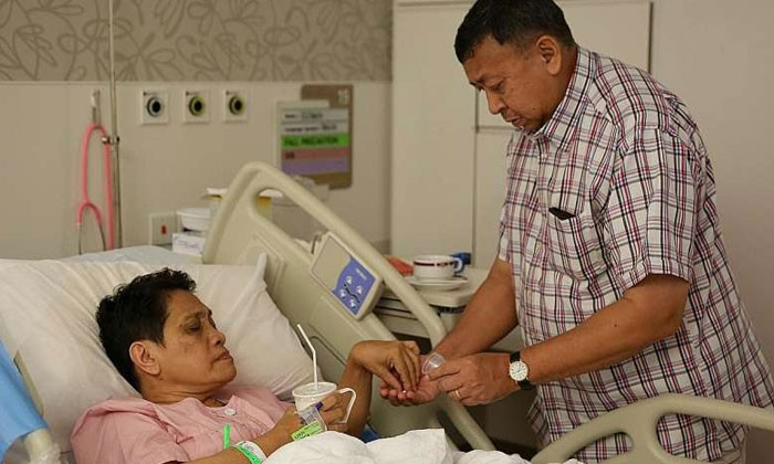 Mrs Jansen, seen here with Mr Jansen, fractured a pubic bone and will be hospitalised for six weeks, and will need two months to fully recover. Photo by The Straits Times (Ong Wee Jin)