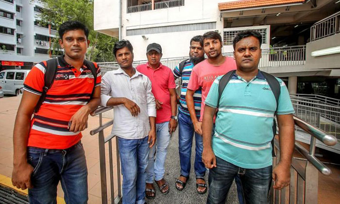 (From left) Foreign workers Motin Abdul, Hossen Shamin, Ahadem Mohammad Faruk, Madbar Yousuf, Prodhan Abdur Razzak and Miah Razzak. TNP PHOTO: DALENE LOW