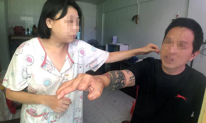 Photo: Shin Min Daily News. Couple who refused to move out