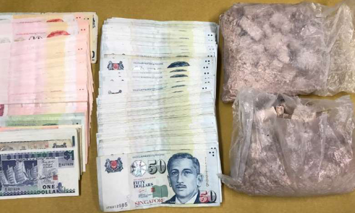 Drugs and cash seized in an operation on April 11, 2017. PHOTO: CENTRAL NARCOTICS BUREAU
