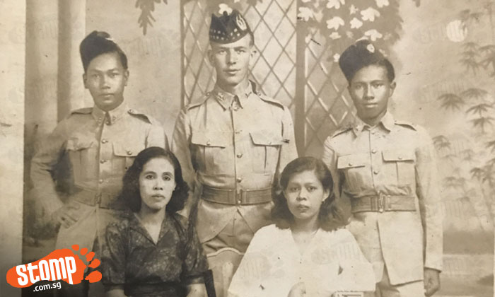 William Angus (top row, middle) flanked by two of his officers. His wife Bibi is seated (bottom row, right) with an unknown woman.