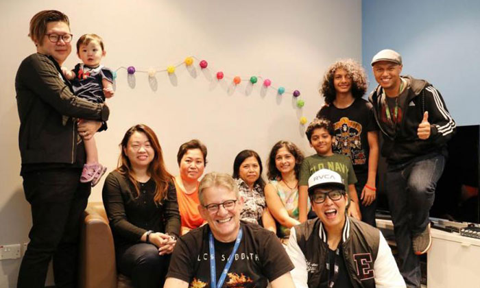 The Flying Dutchman and Glenn Ong (front row) and Andre Hoeden (right) with the two families and their maids. PHOTO: ONE FM 91.3