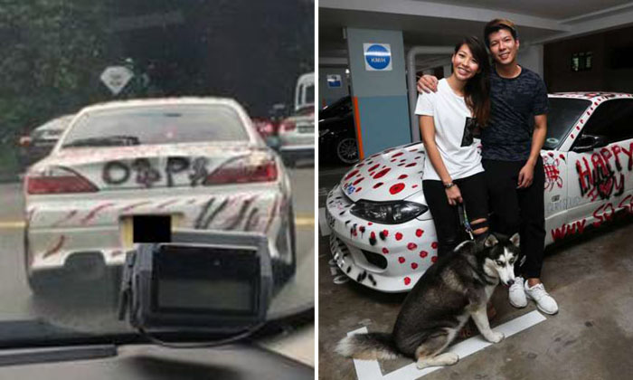 Mr Sim Yumin, 36, and his girlfriend Shereen Tan, 29, pose with Mr Sim's heavily-vandalised Nissan Silvia S15. PHOTO: ZAIHAN MOHAMED YUSOF