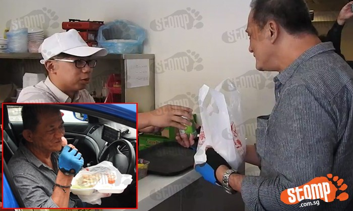 Staff at The Yang's Traditional Hainanese Chicken Rice giving cabby Yu Fook Wah free chicken rice and a canned drink.