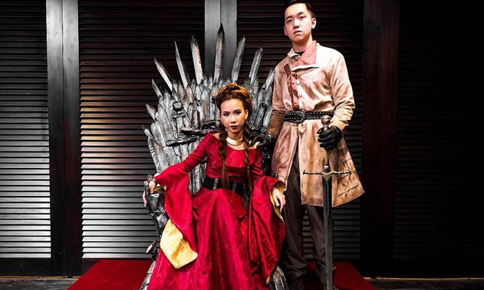Ms Charlotte Lun and Mr Derek Lee on the Iron Throne replica they constructed. PHOTO: KC OF FLEUR D'SIGN