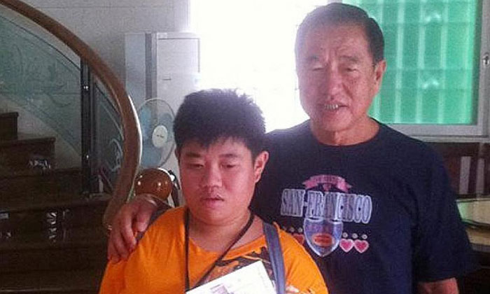 Mr Tang Soh Ha with his daughter, Miss Tang Hui Yee, who was a student at the Movement for the Intellectually Disabled of Singapore. PHOTO: FACEBOOK