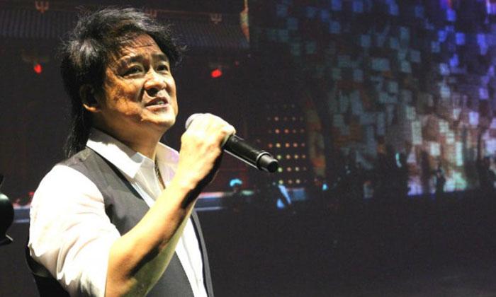 Photo: Rock Records. Wakin Chau performing.