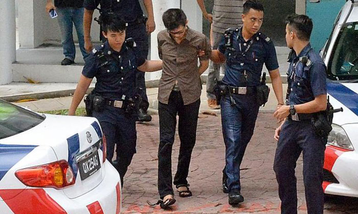 Police arrest a man after he barricaded himself in a flat. PHOTO: SHIN MIN DAILY NEWS