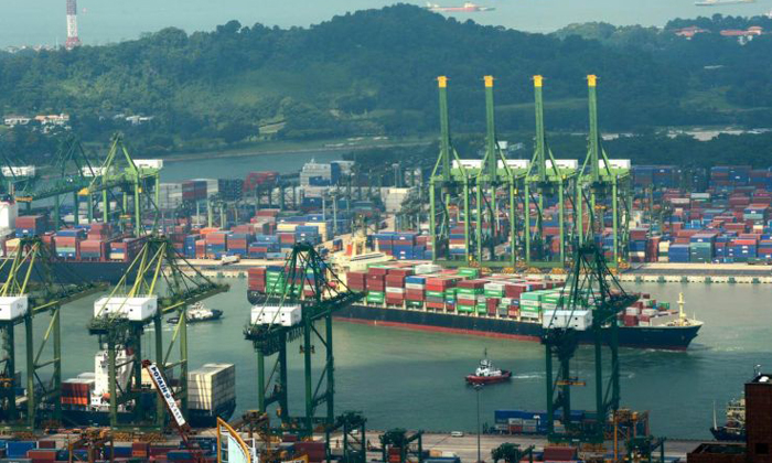 According to the port operator's website, there are 37 quay cranes at the Keppel facility. PHOTO: ST FILE