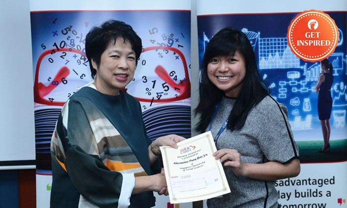 Chermaine (right), receiving her bursary from ISCA Cares Chairperson Mrs Lim Hwee Hua