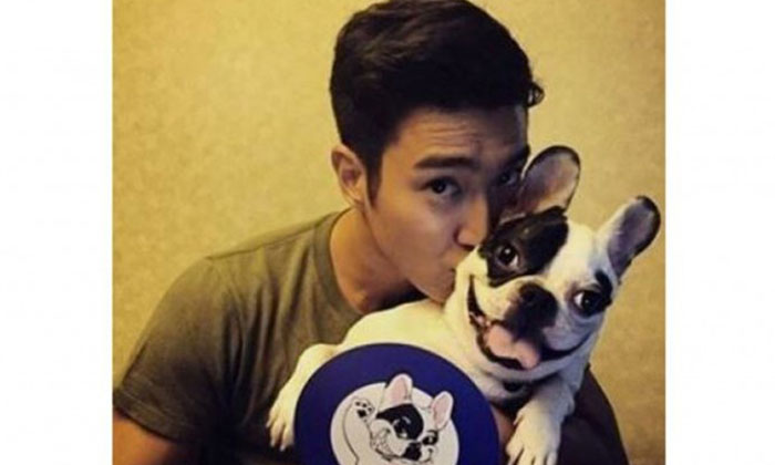 Choi Siwon with his pet dog Bugsy. Photo: Instagram
