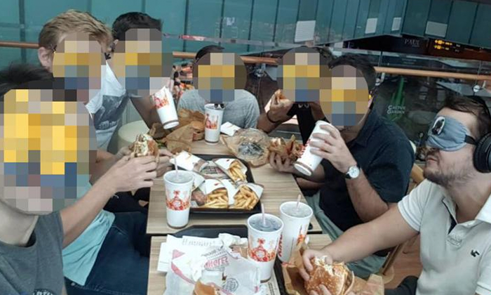 Paul, the groom-to-be (rightmost) having a meal with his friends who planned the prank. Photo: Shin Min Daily News