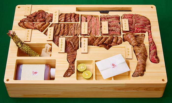For $3,516.17, you get 4.5kg of different cuts, served in an actual wood bento box which displays the cuts in compartments correlated to the shape of a cow. Photo: Gochikuru