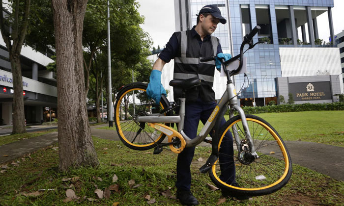 Mr Zhivko Girginov, with a bike found in the Farrer Park area yesterday. He focuses on damaged bikes which may pose a threat to the safety of users. ST PHOTO: KEVIN LIM