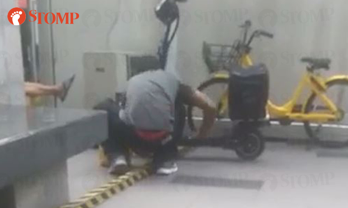 A man was caught on camera cutting the lock of a Deliverooe-scooter before taking it away at Tiong BahruPlaza