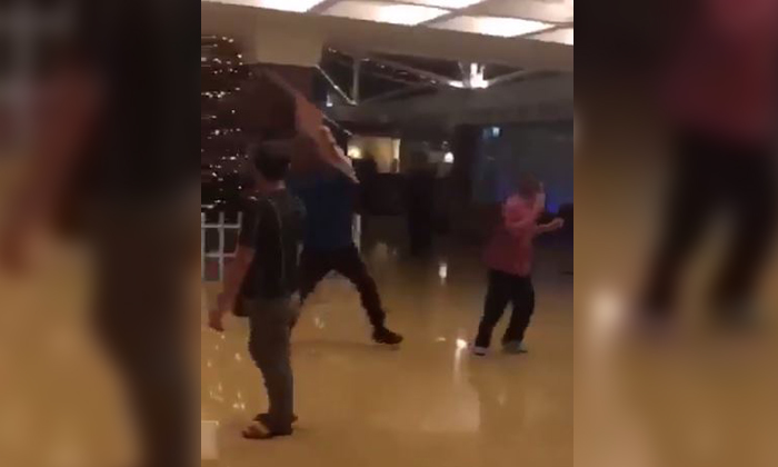 The men were caught on camera fighting and throwing chairs at one another