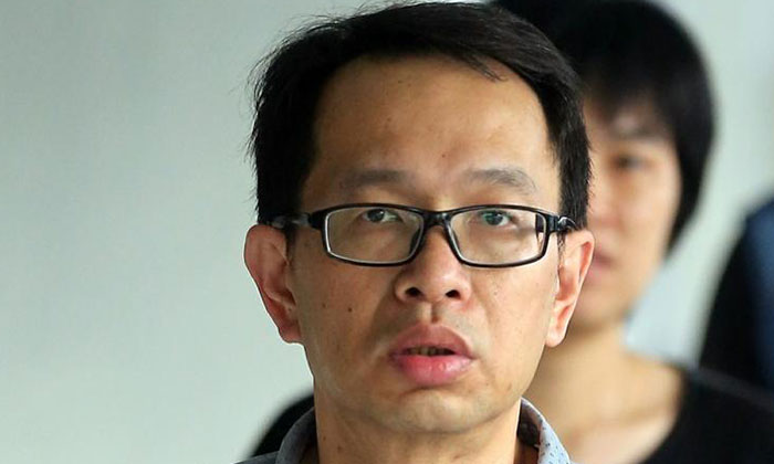 Edward Loh Teik Khoon (middle) had driven off with another motorist on his vehicle's bonnet.