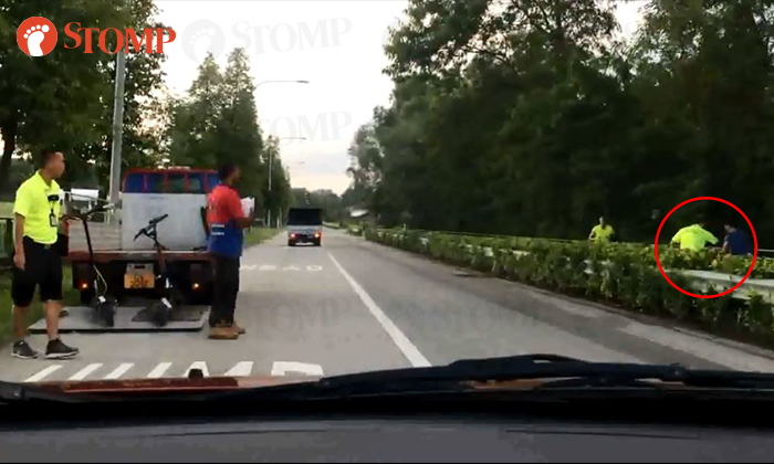 A e-scooter rider proceeded to run away after being stopped by a LTA officer PHOTO: SAM JUNIOR/FACEBOOK
