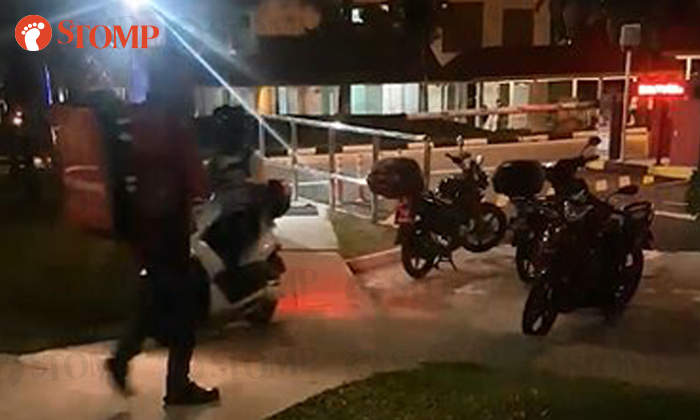 A biker has been spotted riding on a pedestrian walkway just to avoid paying parking fees at a carpark gantry in Tampines
