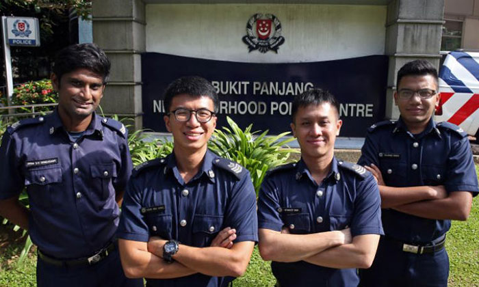 (From left) Sergeant Prem Rengasamy, Staff Sergeant Chan Wai Hong, Staff Sergeant Stanley Koh and Special Constable Corporal Rajdave Singh helped pull a maid dangling off a fifth-storey ledge to safety at Bukit Panjang Ring Road on Dec 6, 2017.ST PHOTO: SEAH KWANG PENG