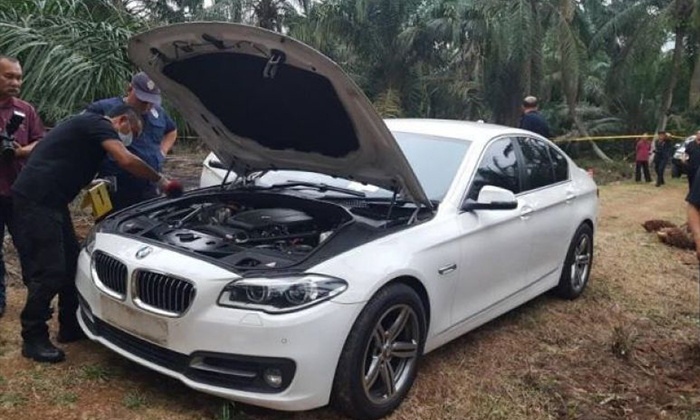 Police recovers the white BMW that was used in the murder of 44-year-old Tan Ah Choy Police recovers the white BMW that was used in the murder of 44-year-old Tan Ah Choy PHOTO: THE STAR/ASIA NEWS NETWORK
