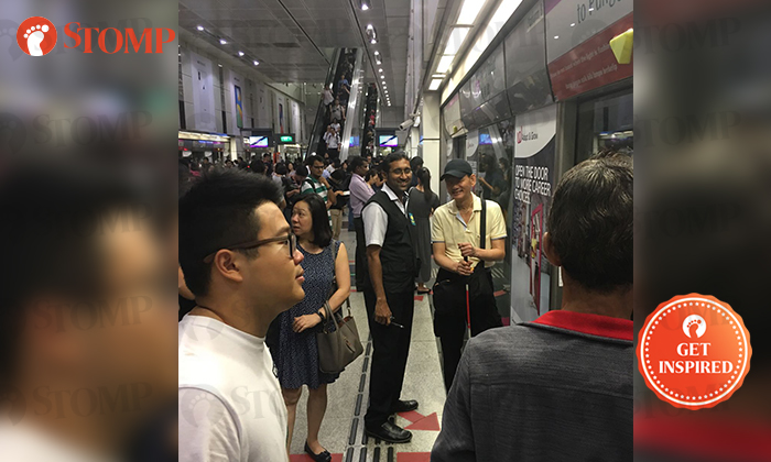 Stomper Goh witnessed a transit security officer helping a visually impaired man at Dhoby Ghaut MRT station.