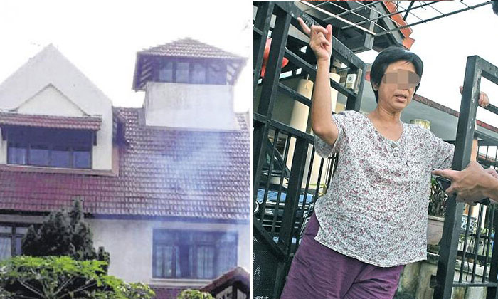 Madam Liu (right) said that the smoke from her home (left) was due to the barbecuing done in preparation for the Chinese New Year. Photo: Shin Min Daily News