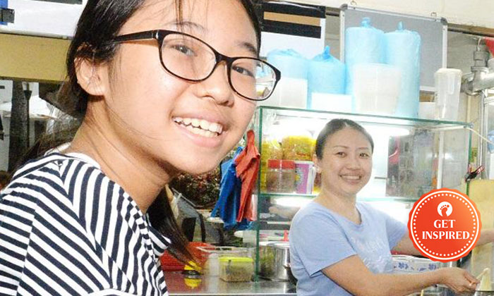 Ms Liang Baoyi (right) said that her daughter (left) always takes time to help out at the stall.