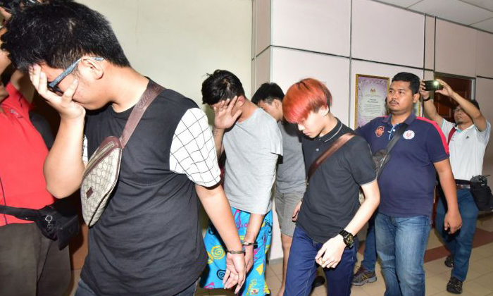 Two men aged 19 and 23, were charged with the murder of 44-year-old Tan Ah Choy at a JB petrol station. PHOTO: CHINA PRESS