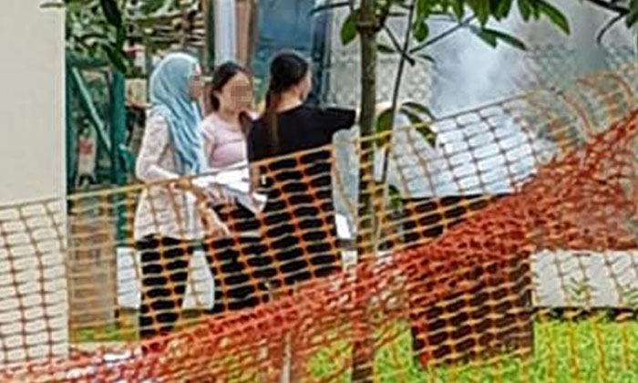 The three women were spotted burning documents in an offering bin.