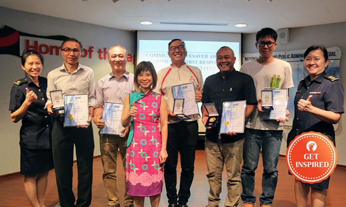 Recipients of the Community Lifesaver and Community First Responder Awards. From Left: MAJ Chia Peng Peng, Mr. Chew Ho Kiat Raymond, Mr. Wong Kuek Phong, Dr. Amy Khor, Mr. Ng Kheng Yong Danny, Mr. Asnadi Bin Robani, Mr. Billy Lim Kuang Lee and LTC Betty Ting