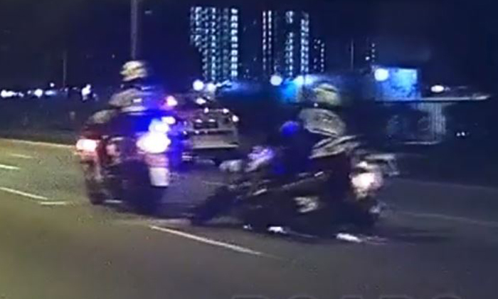 TP officer skids after coming into contact with glass shards on road. (PHOTO: ROADS.SG)