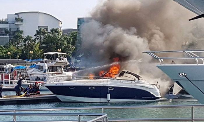 A photo taken by a passer-by shows the yacht engulfed in flames while berthed at the club.PHOTO: SHAZAN