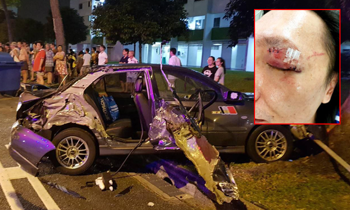 A chain collision caused Mr Michael Ng's car to hit a tree and road sign. Mr Ng (inset) suffered cuts on his eyelid and forehead. Photos: Michael Ng / Facebook, Lianhe Wanbao