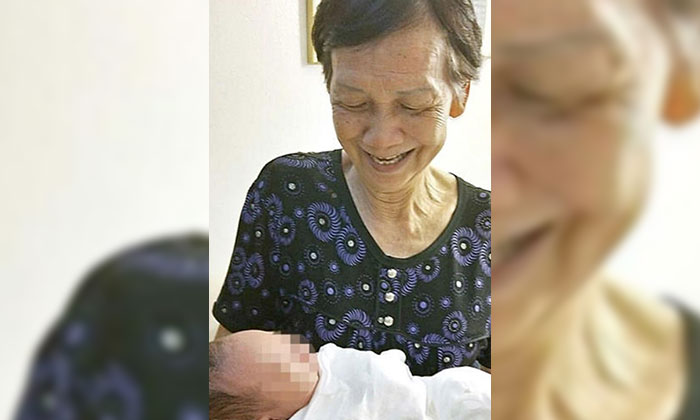 Madam Wang had retired from her job a month ago to look after her first great-grandson. Photo: Shin Min Daily News