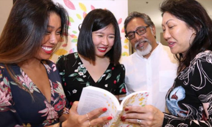 Mr Pragash's sister (leftmost), mother (rightmost) and father (2nd from right) were also present at the launch of 'Stay Gold', a biography of their son written by Ms Clara Lock (2nd from left). PHOTO: LIANHE WANBAO