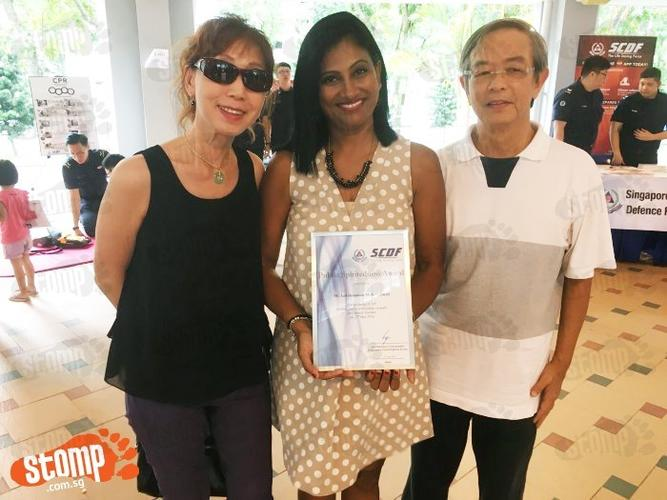 Kind woman who helped injured elderly at Chinese Garden meets him after reading his Stomp report, gets big hug from him and receives SCDF award