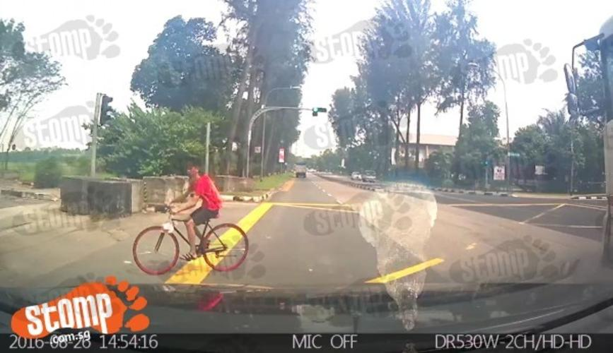 Driver nearly hits young boy who recklessly cycled across road at Yuan Ching  junction