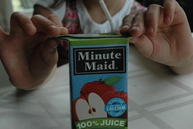 That's not how you do it! No wonder you keep spilling! Pull the sides of your juice box so that you can hold the box without pressing so much it ends up spilling. Yeah, unbelievable!