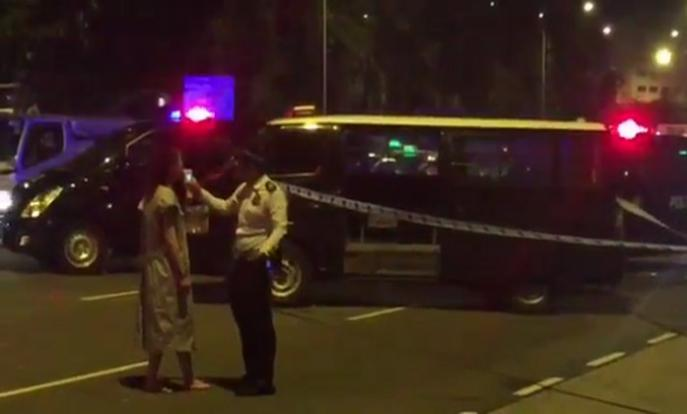Traffic Police administering a breathalyser test on a driver at a road block on Keppel Road in the wee hours of March 18. ST VIDEO: SEOW BEI YI