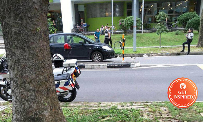 The boy was hit by a car while using a raised zebra crossing in Geylang East Avenue 1. PHOTO: SHIN MIN DAILY NEWS READER