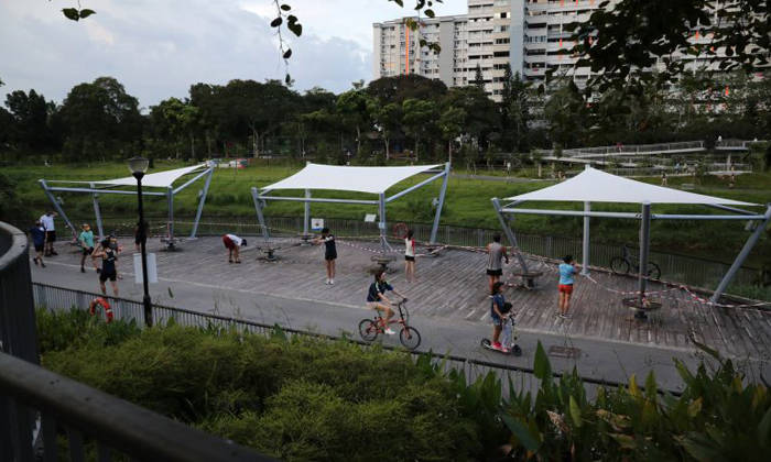 While it is not encouraged, individuals may leave home to exercise alone or only with members living in the same household. Photo: The Straits Times