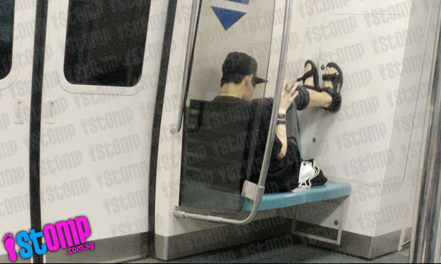 Man occupies reserved seat on MRT -- and rests his legs on the train wall
